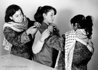 Jordan, 1970. Palestinian girls in Amman tryin
